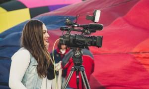 Female student using a camera