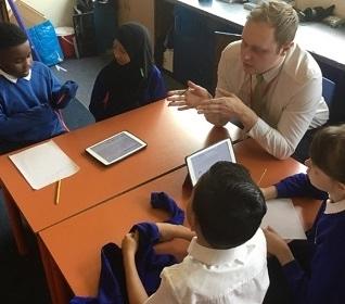 Student, Ben Hobbis, working with children in school