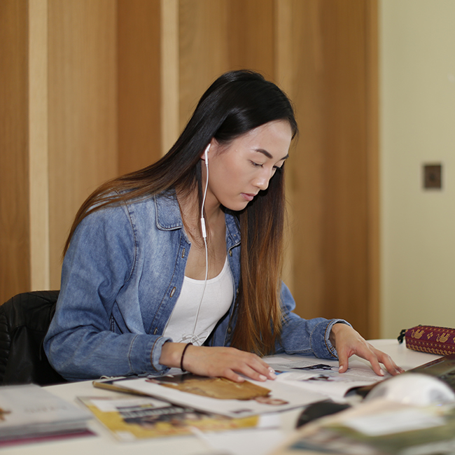 student at work in library