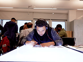 Student working on lightbox