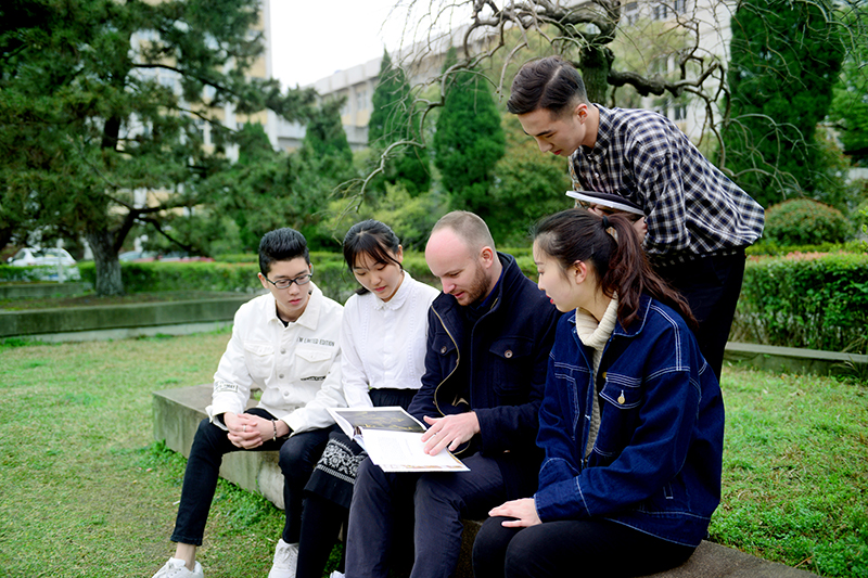 Lecturer and students outside campus