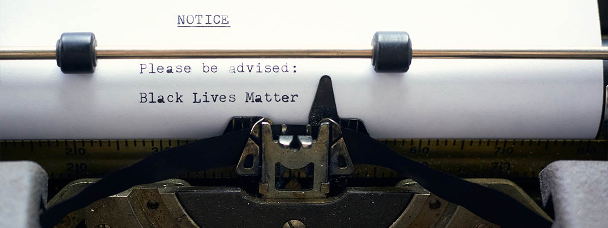 "BLM Books 1200x450 - Typewriter with the words ""Please be advised - Black Lives Matter"""