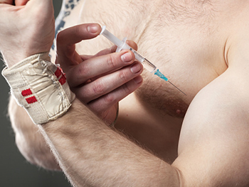 Centre for Applied Criminology Sports Criminology Page Image 350x263 - Man injecting steroids