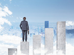 Centre for Enterprise, Innovation and Growth Image 1 - Business man stood on a graph looking over a city