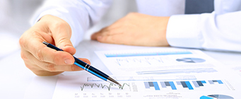 Centre for Enterprise, Innovation and Growth - Staff 341x140 - Man looking at financial information