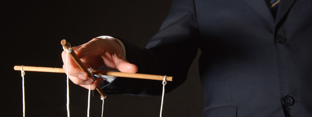 Coercive Control 1200x450 - Man holding puppet strings
