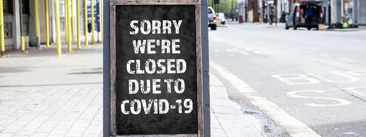 "Covid Hospitality 1200x450 - Board saying ""Sorry we're closed due to COVID-19"""