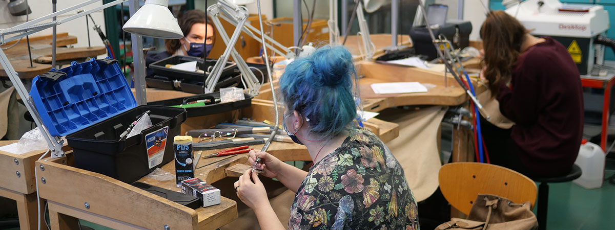 Jewellery students working in the studio wearing face coverings