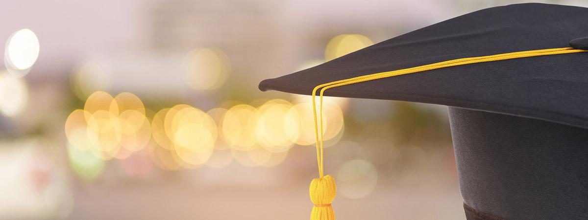 Desecuritising 1200x450 - Graduation cap