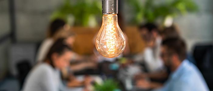 Enterprise@BCU 700x300 - A light bulb above young entrepreneurs
