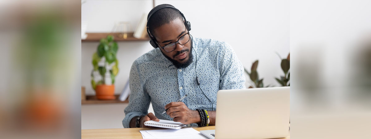 Entrepreneur Podcasts 1200x450 - Man listening to podcasts, making notes