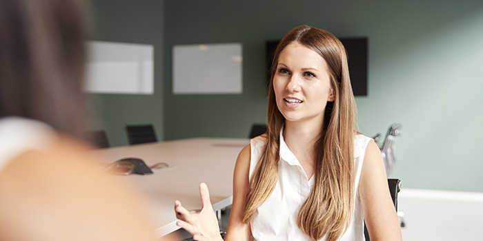 Executive Education 1 700x350 - Woman talking in a boardroom