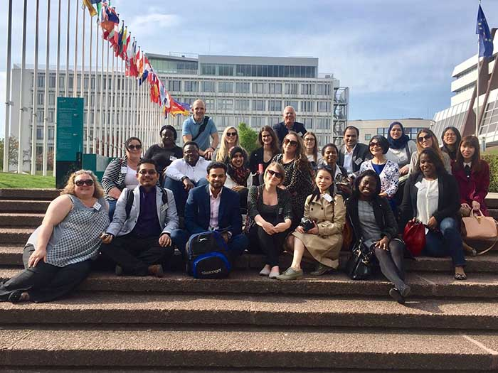 International PG Study Trip Germany 2017 700x525 - Students sat on steps