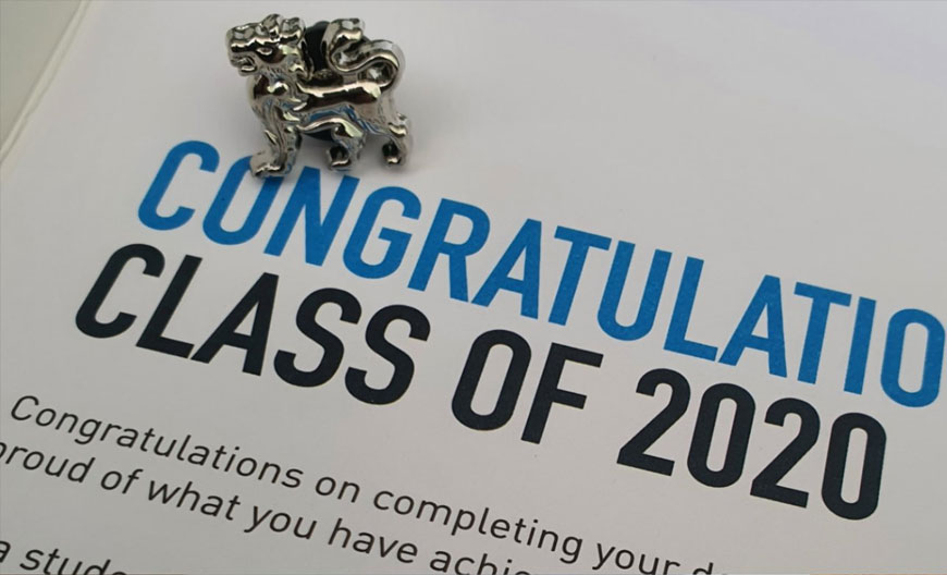 BCU pin badge and letter saying Congratulations Class of 2020