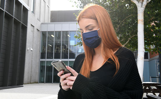 Student on campus in face mask