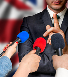 Centre for Brexit Studies - News Flip Card Image 227x255 - Man taking questions in front of a Union Jack flag