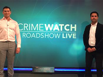 Imran Awan Crimewatch 350x263 - Imran stood infront of a Crimewatch logo