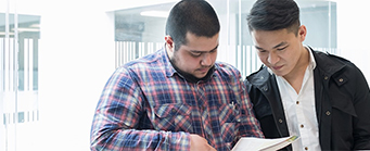 Innovation Management Image 341x139 - Two men looking at an iPad