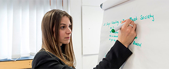 Internal Audit Image 341x139 - Woman writing on a board