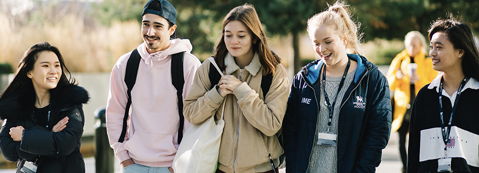 Picture of students walking through campus