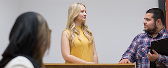 International Law Image 341x139 - Man and Woman in courtroom