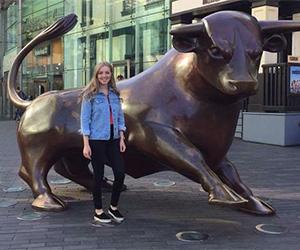 Katie Bollard Three Favourite Things Image 3 300x250 - Katie standing next to the Bull statue
