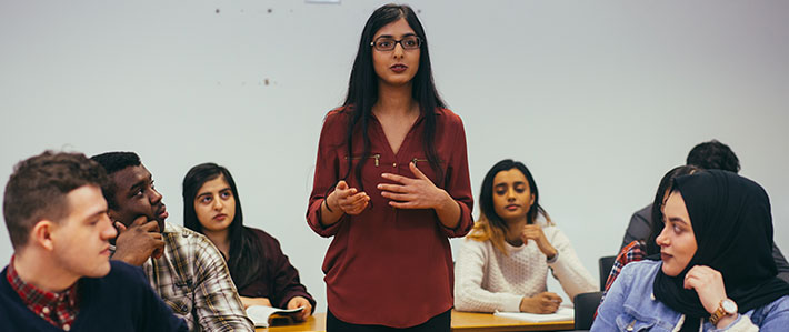 Law School - 10 Reasons Why Image 710x299 - woman speaking in a classroom