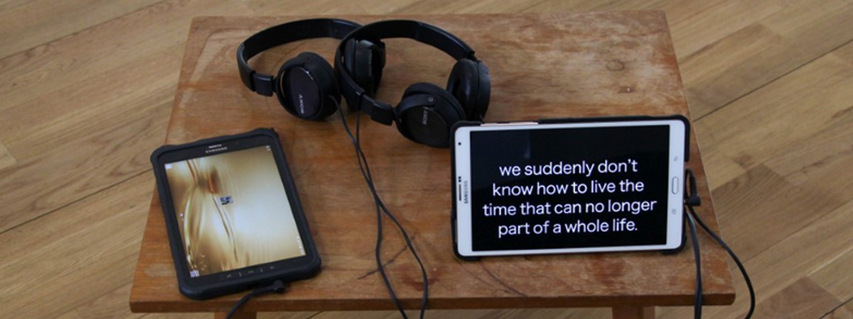 Tablets and headphones at exhibition
