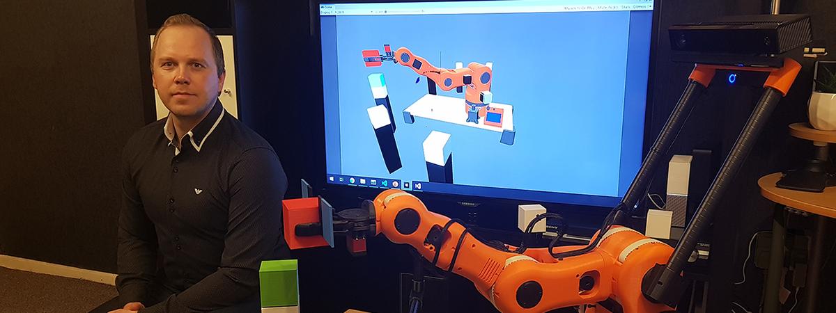 Marius sat next to his robotic arm