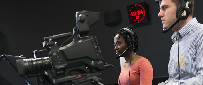 Media students operating TV cameras