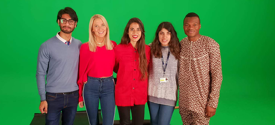 Students in the green screen studio filming for the We are International video.