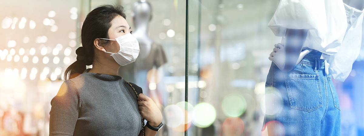 Shopper outside store in facemask