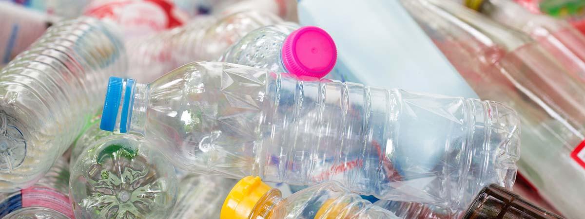 Plastic Campaign 1200x450 - Plastic bottles in a pile