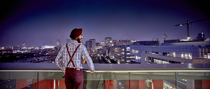 Student looking out over Birmingham skyline