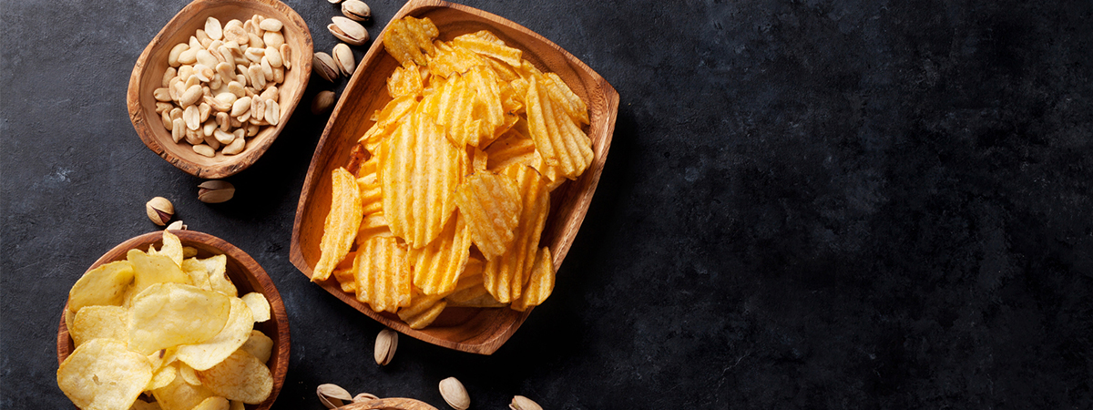 Image of crisps and nuts on a table