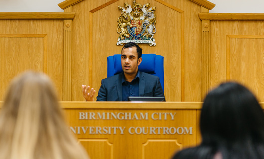 Law School - News - ATD - See Out Kit Image 530x320 (Man sat in the mock crown court)
