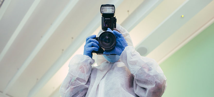The Branches of Social Sciences Explained Criminology 880x400 - Person holding a camera in a crime scene suit