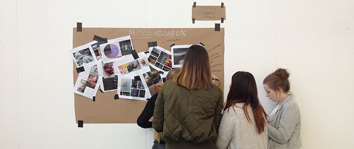 Students working on a moodboard