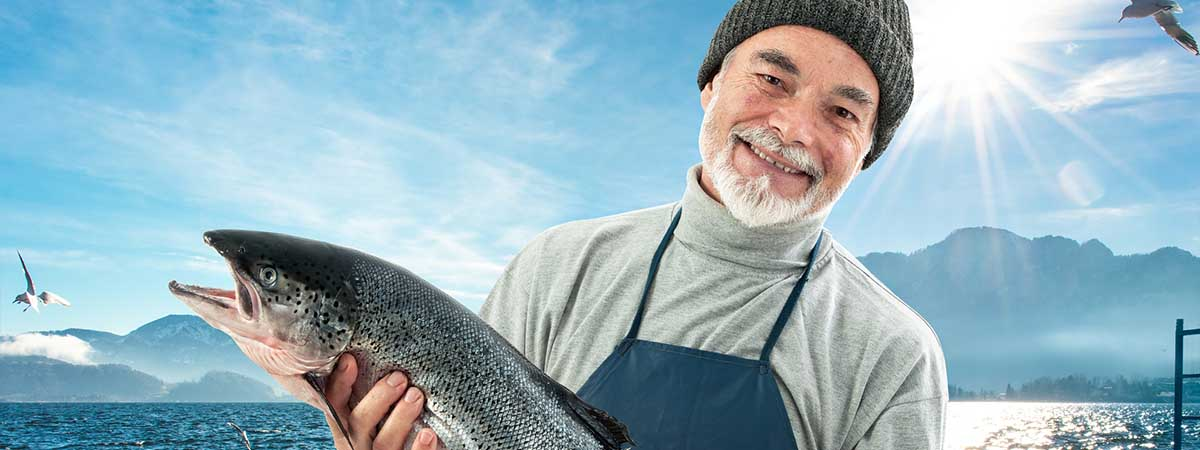 Weird Law 1200x450: Man holding a salmon
